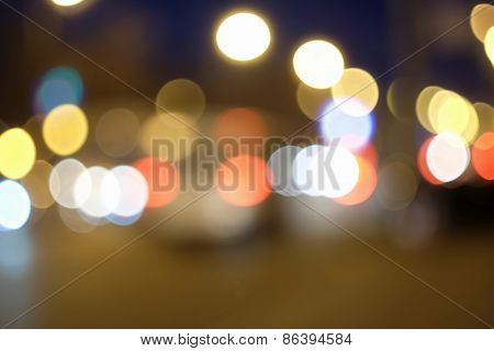 Carlights defocused. Background of blurred street lights in the night