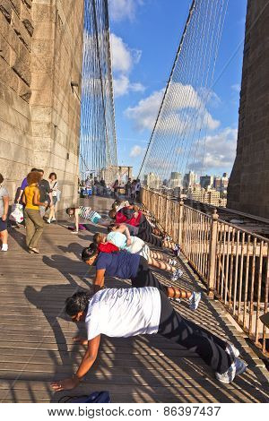 People Are Doing Push-up Exercises At The Brooklyn Bridge