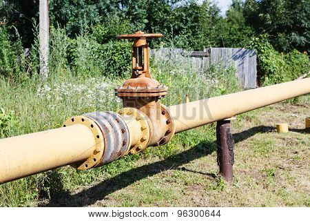 Gas Line In Village In Summer Day