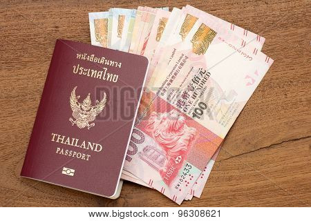 Thailand passport with hongkong currency. brown passport with world currency on teak wood texture table poster