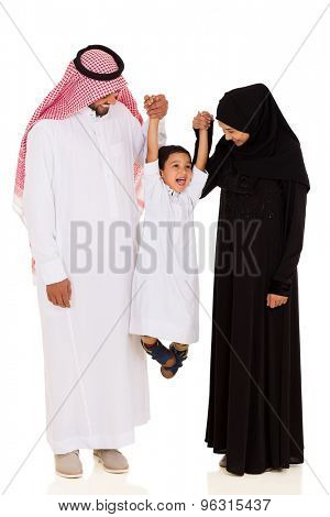 cheerful young muslim family having fun on white background