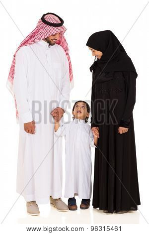 lovely young islamic family standing on white background