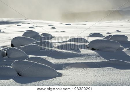 Snowy Volcanic Rocks In South Iceland