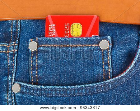Credit card in jeans pocket - shopping background