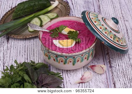 Beetroot Soup - Cold Soup With A Beet And Egg Submitted To A Soup Tureen, Bread With Garlic And A Ba