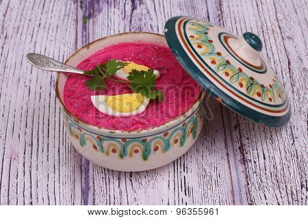 Beetroot Soup - Cold Soup With A Beet And Egg Submitted To A Soup Tureen On A Wooden Table