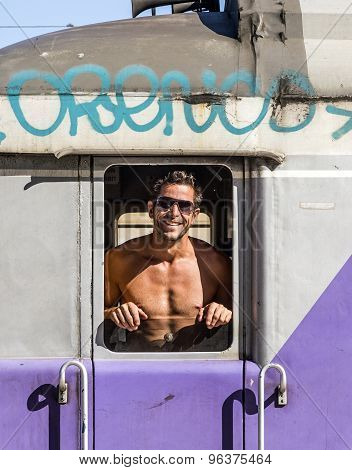 Attractive Train Conductor In His Train Is Proud To Show His Muscles