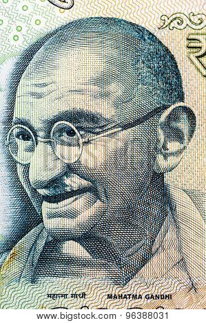 Closeup of Mahatma Gandhi on 100 Rupees Indian currency note