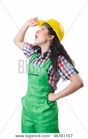 Female workman in green overalls isolated on white poster
