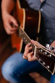 Close-up of musician playing guitar selective focus poster