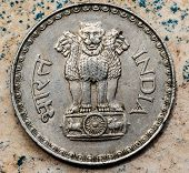 ASHOKA PILLAR emblem represented in Indian coin, emblem depicting 4 lions back to back, the fourth lion is not visible poster