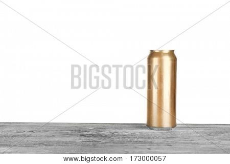 Can of beer on table against white background