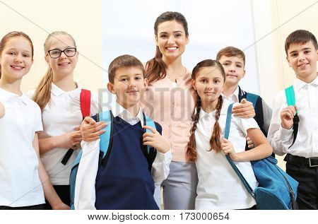 Teacher with children in school corridor during class break