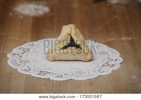 Fresh pastry with prunes on a bakers table