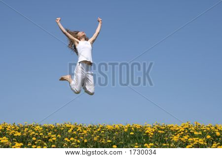 Smiling Young Woman In A Happy Jump