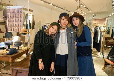 HONG KONG - CIRCA NOVEMBER, 2016: indoor portrait of three women at initial store in Hong Kong. Shopping is a widely popular social activity in Hong Kong.