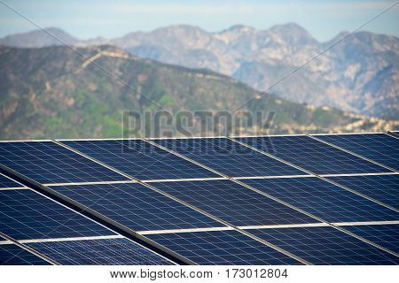 Solar panel with mountains on sunny day. Green economy efficient energy safety for environmental concept.