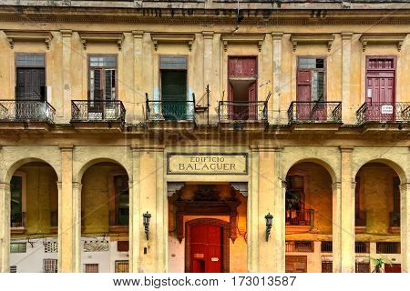 Havana, Cuba - Jan 7, 2017: Edificio Balaguer - old run down apartments in Old Havana Cuba.