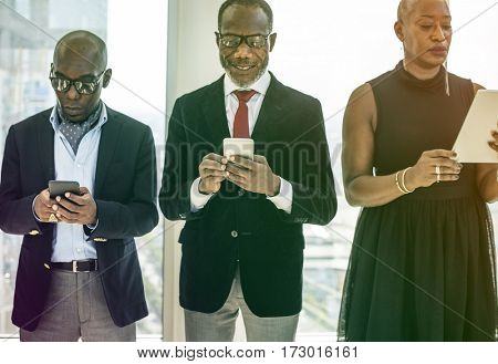 Diverse business team using devices