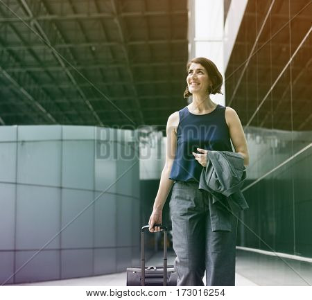 Businesswoman with luggage on the way to traveling