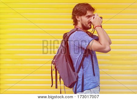 Photo Gradient Style with Man taking a photo yellow wall background
