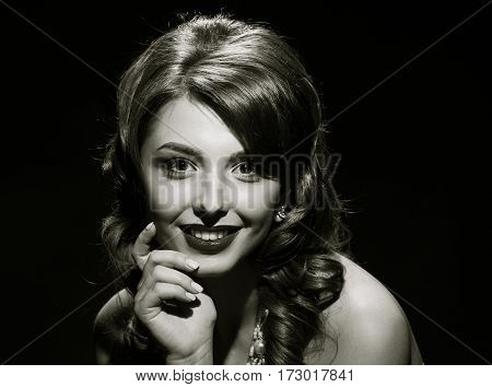 woman studio portrait in hollywood style light on black background with space. in black and white toning