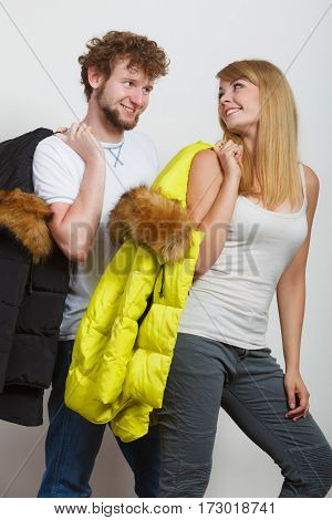 Happy joyful couple with fashionable jackets. Young man and woman in studio. Winter autumn fall fashion.