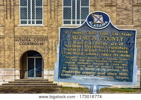 Prattville Alabama USA - January 28 2017: Close of up the Alabama Historical Association historic marker for Autauga County with the Autauga County courthouse in the background.
