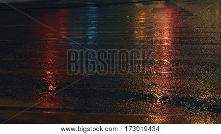 Wet old crosswalk in the night lighting