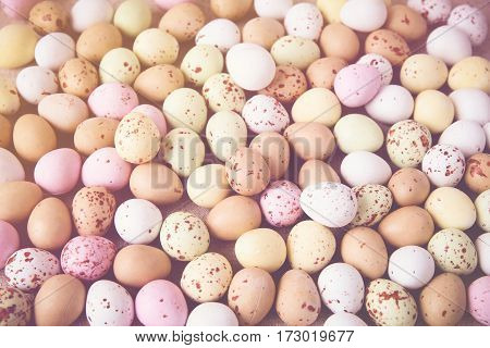 Easter pastel speckled eggs selective focus background toning