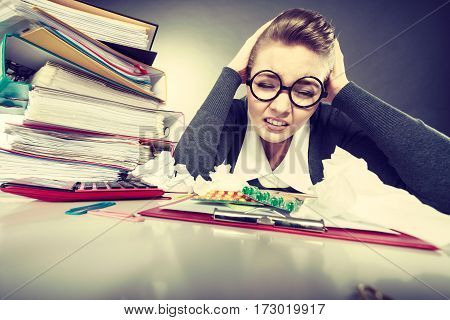 Businesswoman Suffering On Hard Headache.