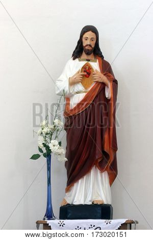 HRVATSKA DUBICA, CROATIA - NOVEMBER 18: Sacred Heart of Jesus statue on the altar in Parish Church of Holy Trinity in Hrvatska Dubica, Croatia on November 18, 2010.