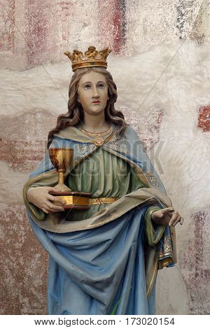 BUCICA, CROATIA - JULY 19: Saint Barbara statue on the altar in the parish Church of Saint Anthony of Padua in Bucica, Croatia on July 19, 2016