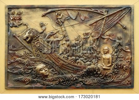KOLKATA,INDIA - FEBRUARY 09, 2016: Soul itself is the strongest power; Sudamstra, a serpent-prince, creates a heavy storm in the river, but fails, bass relief on the wall of Jain Temple in Kolkata,