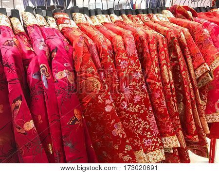 Traditional red and pink Chinese blouse on hanger for Chinese new year