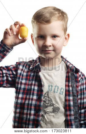 A little boy holds a toy in his hand with a smile, isolated white background, guy in a plaid shirt