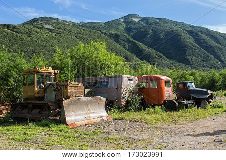 Old special machines in brookvalley Spokoyny at the foot of outer north-eastern slope of caldera volcano Gorely.