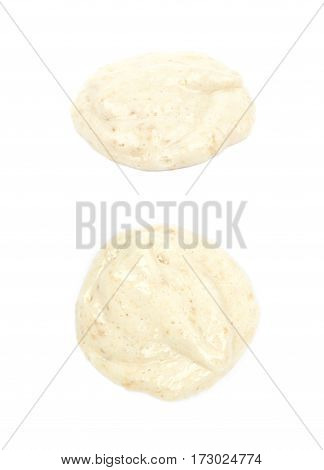 Puddle of the mashed banana puree isolated over the white background, set of two different foreshortenings