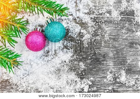 Christmas tree and decorations on the old wooden table. Picturesque winter composition. Holiday mood. Xmas and New Year fairy tale background with sparkling bokeh lights. Beautiful greeting card.
