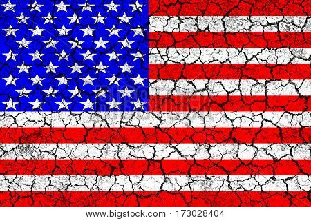 Flag of USA painted on cracked wall. Political concept. Old texture. Vintage design. USA flag on cracked earth. Famine and drought. Natural disaster. Front view.