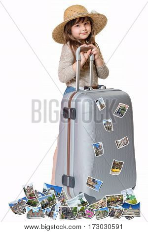 Long haired little girl with straw hat is standing and leaning on a suitcase. Photos of the sights of Amsterdam flies around the suitcase. All is on the white background. Vertically.