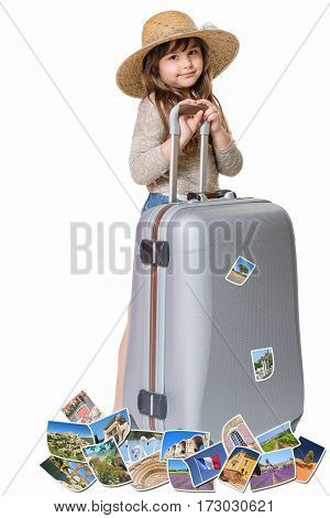 Long haired little girl with straw hat is standing and leaning on a suitcase. Photos of the sights of Provence (France) flies around the suitcase. All is on the white background. Vertically.