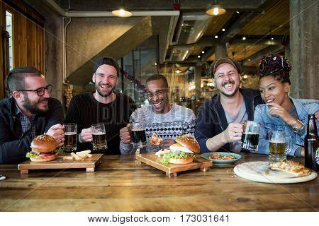 Diverse People Enjoy Food Drinks Party Restaurant
