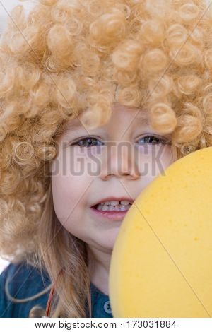 Close Up Child Face With Curly Wig