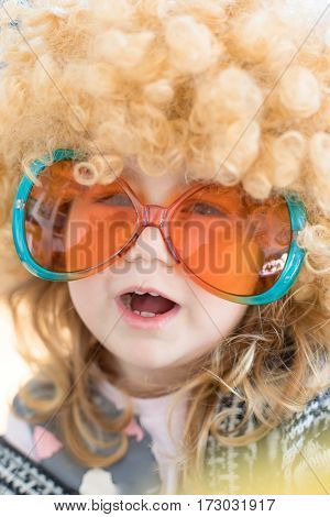 Close Up Funny Child Disguised As Sixties