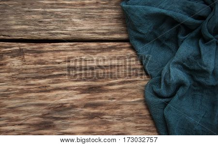 Napkin on a old wooden background - top view