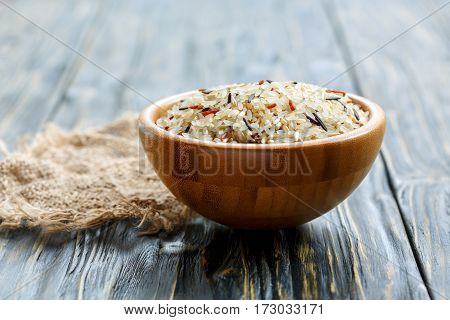 White, Red, Brown And Wild Rice In A Wooden Bowl.