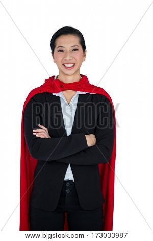 Portrait of woman pretending to be a super hero on white background