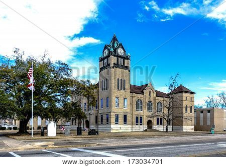 Prattville Alabama USA - January 28 2017: Landscape view of the Autauga County Courthouse with partly cloudy sky.