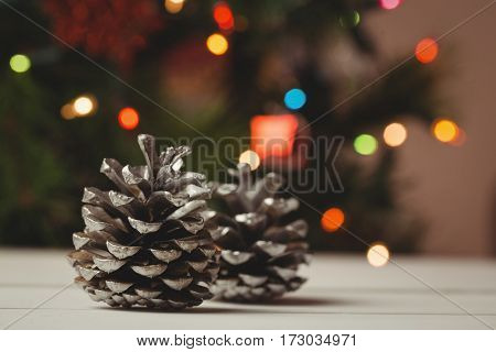 Two pine cones on wooden table during christmas time